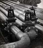 Oil and gas pipe line valves. Black and white — Stock Photo