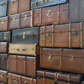 Conceptual picture of the wal of suitcases — Stock Photo