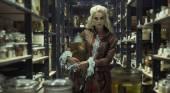 Blond attractive woman in the retro laboratory — Stockfoto