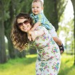 Laughing mom playing with her baby child — Stock Photo #55223205