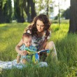 Mother reading fairy tales for the child — Stock Photo