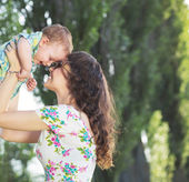 Tender mom tossing her child — Stock Photo