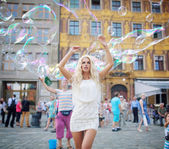 Pretty young blonde among lots of bubbles — Stock Photo