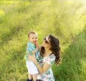 Brunette mom carrying her lovely son — Stock Photo