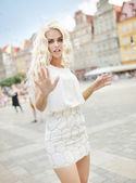Photo presenting blonde catching bubbles — Stock Photo