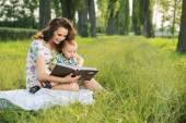 Brunette  mother reading tales for her child — Stock Photo