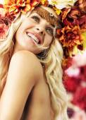 Beautiful smiling woman with colorful wreath — Stockfoto