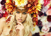 Marvelous blonde woman with flower hat — Stockfoto