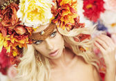 Portrait of the serious blonde wearing huge wreath — Stock Photo