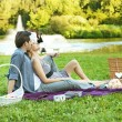 Cheerful couple relaxing in the park — Stock Photo