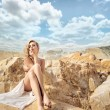 Sensual blonde with the beautiful landscape behind — Stock Photo #55249507