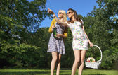 Two joyful ladies wearing trendy wooden sunglasses — ストック写真