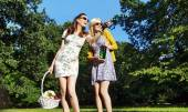 Girlfriends looking for place for picnic — Stock Photo