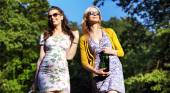 Couple of attractive girlfriends on the walk — Stockfoto