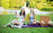Portrait of the laughing women sitting on the purple blanket — Stockfoto