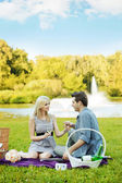 Couple having romantic date in the park — Stock Photo