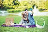 Young cheerful couple making the self photo — Stock Photo