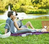 Cheerful couple relaxing in the park — Foto Stock