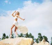 Portrait of the cutie dancing on the rocks — Stock Photo