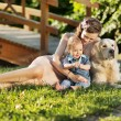 Mother hugging son and pet — Stock fotografie #55253617