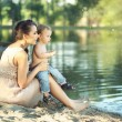 Mom with son looking at the lake — Stock fotografie #55254711