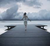 Woman on the jetty — Stockfoto