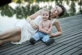 Brunette mother posing with her son — Stock Photo