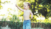 Small boy playing in the garden — Stock Photo