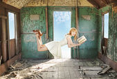 Glad levitating redhead with the book — Stock Photo