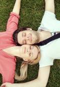 Portriat of the lying and relaxing couple — Stock Photo