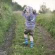 Small boy walking on the forest path — Stock Photo #56674061