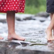 Children soaking feet in a brook — Stock Photo #56674131