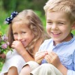 Portrait of cute children with flowers — Stock Photo #56674227