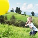 Joyful boy bouncing a balloon — Stock Photo #56674685