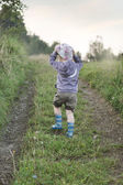 Small boy walking on the forest path — Stock Photo