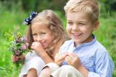 Portrait of cute children with flowers — Stock Photo