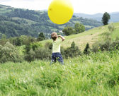 Small boy playing a huge balloon — Stock Photo