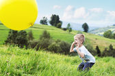 Joyful boy bouncing a balloon — Stock Photo