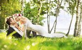 Just married couple relaxing on the meadow — Foto Stock