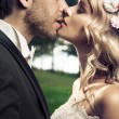 Portrait of the kissing marriage couple — Stock Photo #56696637