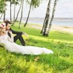 Couple spending honeymoon by the lakeside — Stock Photo #56697219