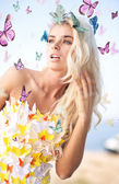 Alluring blonde wearing butterfly dress — Stock Photo