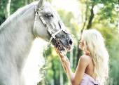 Fabulous woman with bright horse — Stock Photo