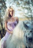 Marvelous woman riding a horse — Stock Photo