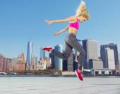 Pretty athlete running in the downtown — Stock Photo