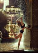 Sexy, fit woman in a fountain — Stock Photo