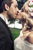 Portrait of the kissing marriage couple — Stock Photo
