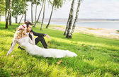 Couple spending honeymoon by the lakeside — ストック写真