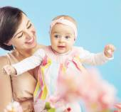 Charming young mother with lovely child — Stock Photo