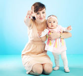 Beautiful mother with cute child — Stock Photo